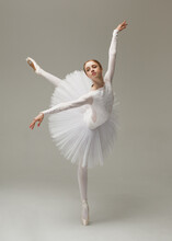Young Woman In White Ballet Dress Dancing Indoors