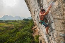 Man Climbing Rock Face In Yang...
