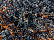 Aerial Overhead View Of Frankfurt Am Main, Germany Skyline At Night With Glowing Streets