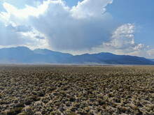 Aerial View Of Dusty Dry Desert Land And Mountain On The Background Lee Vining Mono County, California, USA