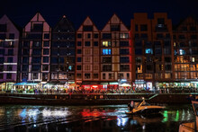Gdansk, North Poland - August 13, 2020: Night Photograph Of Medieval Style Polish Architecture Over Motlawa River Located In The Old Town Near Baltic Sea