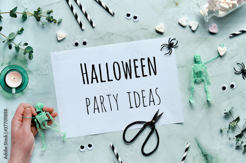 Fotografie, Tablou Clipboard with text Halloween Party ideas on mint green Halloween background