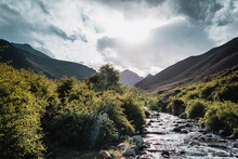 Stream During A Sunset In The Andes Mountain Range