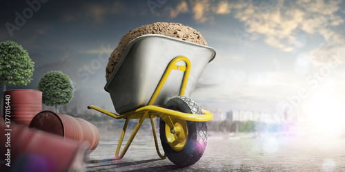 Fotografia Wheelbarrow full of sand in city