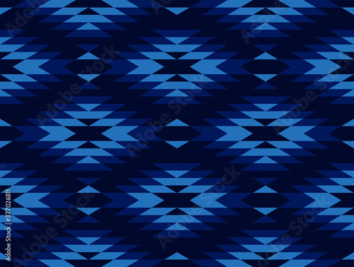 Tribal and ethnic pattern in blue geometric triangle, seamless vector abstract b Canvas Print