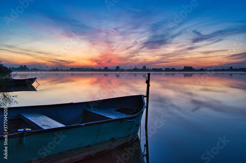 Wooden boats during the dawn on Lake Kunice