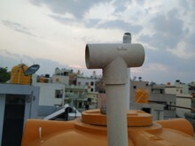 Fixed Plastic PIpe To Solar Geyser Panel Or Drum And Cityscape View From Top Of The Terrace In A Pipe