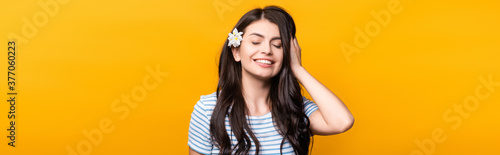 Billede på lærred brunette young woman with flowers in hair and closed eyes smiling isolated on ye