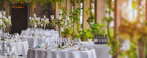 decorated table with candles and flowers in a luxury restaurant Canvas Print