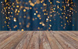 canvas print picture holiday illumination and decoration concept - empty wooden surface or table with christmas golden lights on blue background