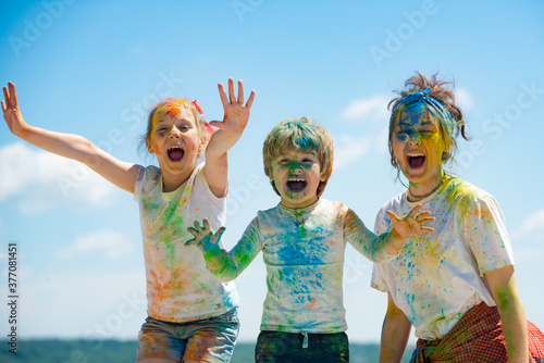 Funny kids face in color splash, coloured powder on children body Canvas-taulu