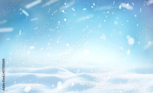Winter snow background with snowdrifts, beautiful light and falling flakes of snow on blue sky, drifting snow, copy space Fototapete