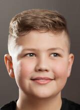 Smiling Teenager Boy On Grey Background