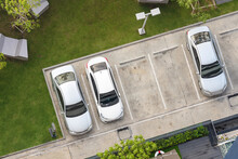 Top View Of Parking Area With Small Garden In Modern Building