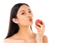 Nude Asian Woman Making Duck Face While Holding Whole Peach Isolated On White