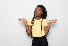 Desperate Young African Woman Asking For Help From Above On White Background