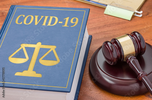 Law book with a gavel - COVID-19 Wallpaper Mural