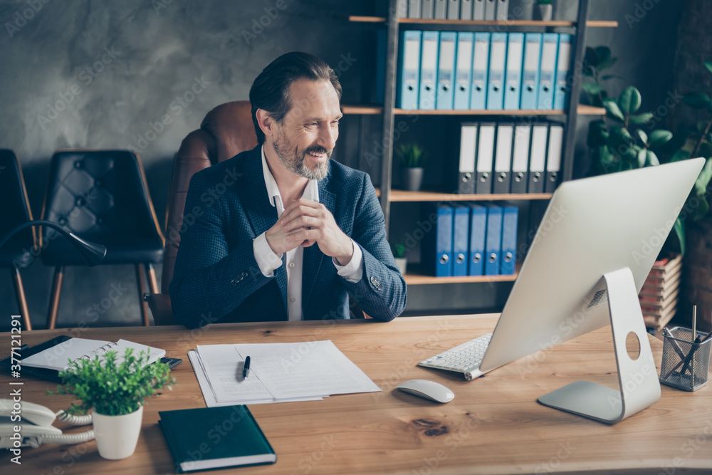 Fototapeta Portrait of his he nice attractive handsome cheerful man ceo boss chief employer meeting online interview hiring candidate vacancy at modern concrete industrial work place station