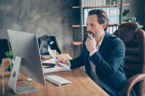 Fototapeta Profile side view portrait of his he nice handsome busy man executive specialist online appointment report project start-up finance result sales at modern concrete industrial work place station obraz na płótnie