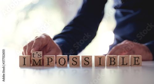 Tablou Canvas Businessman Changing The Word Impossible To Possible By Flipping Over Wooden Cube