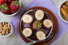 Brazilian Typical Acai Bowl With Fruits And Muesli Over Wooden Background. Top View