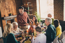 Photo Of Full Family Eight People Gathering Sit Two Little Kids Bristled Father Cut Fry Turkey Lovely Talking Funny Laugh Served Dinner Big Table Generation In Evening Living Room Indoors