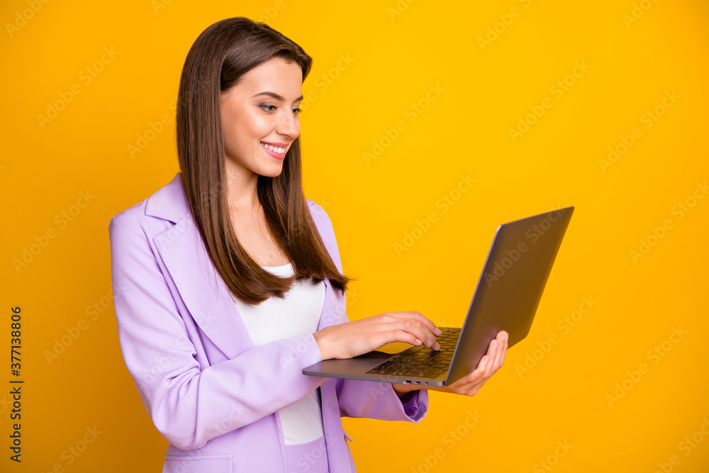 Fototapeta Profile photo of nice business lady holding notebook hands chatting with colleagues partners corporate questions wear lilac office suit isolated yellow color background