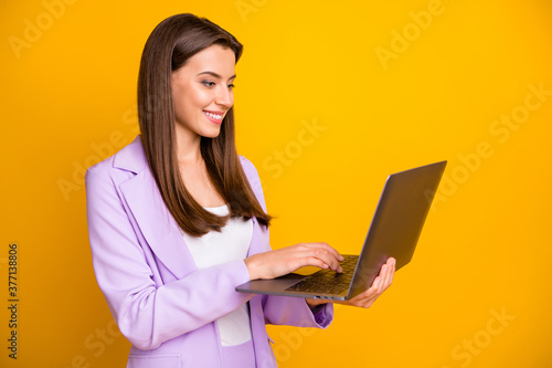 Fototapeta Profile photo of nice business lady holding notebook hands chatting with colleagues partners corporate questions wear lilac office suit isolated yellow color background obraz