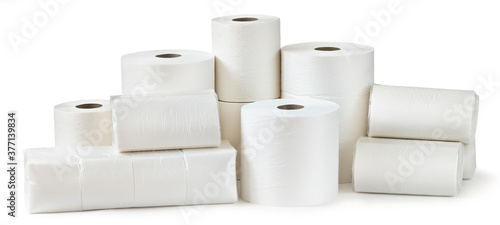 Fototapeta Rolls of toilet paper, paper towels and packs of napkins isolated on white background obraz