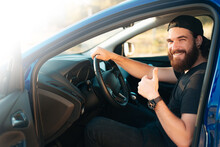 Photo Of Handsome Driver Man Showing Thumb Up And Sitting In Car And Looking At The Camera