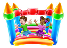 Children Jumping And Bouncing On A Kids Bouncy Inflatable Castle House