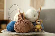 Toy Bear, Clews With Needles And Crochet On Table. Engaging In Hobby