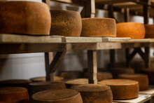 Loops Of Cheese In On Wooden S...