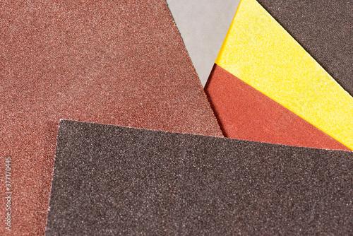 Photo brown sandpaper for woodworking. Macro abrasive material