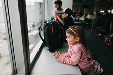 Young Girl Traveling On A Plane