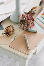 Natural Notebook On Wooden Table With Dry Flowers