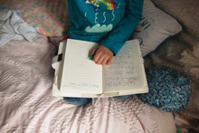 Girl Writes In Diary In Bedroom