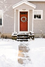 Pretty Door House In The Snow