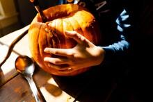 Stock Photo Of Boy Carving A Pumpkin