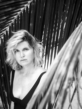 Black And White Portrait Of A Beautiful Blonde Girl On A Background Of Palm Trees