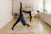 Two Adult Women Practice Yoga ...
