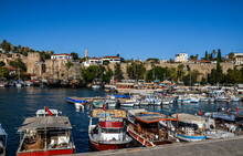 View Of Boats Yachts And Tourist Galleons Moored In Old Marina Or Port Harbor Kaleici At Mediterranean Sea. Antalya, Turkey