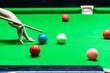 Leinwandbild Motiv A man playing snooker in bar. Snooker player aiming snooker ball on snooker table.