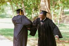 Senior African Men In Graduation Caps And Robes
