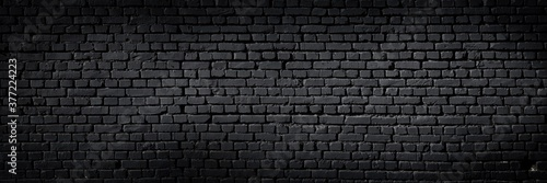 Fototapeta Texture of a black painted brick wall as a background or wallpaper obraz