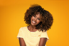 African Afro Woman With Curly Hair Smiling.