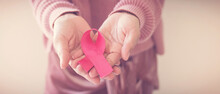 Woman Hands Holding Pink Ribbo...
