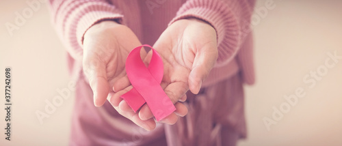 Valokuva woman hands holding pink ribbon, breast cancer awareness, October pink, World ca