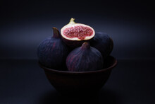 Tasty Figs On A Black Backgrou...