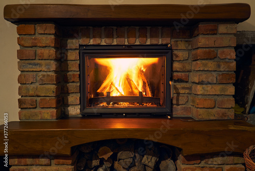 Valokuvatapetti fireplace and fire close view as object or background, brick wall